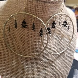 HANNAH  gold hoop with dangling skulls